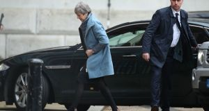 Prime Minister Theresa May arrives at the rear entrance of Downing Street, London, after spending the weekend in her Maidenhead constituency. Yui Mok/PA Wire