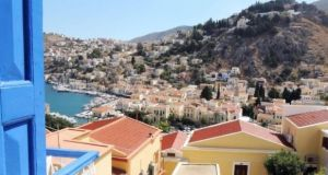 In the Dodecanese island of Symi, this three-bedroom villa overlooks the island's Venetian harbour