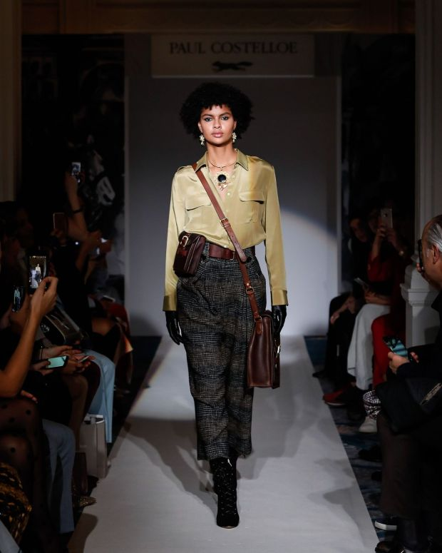 A model presents one of Paul Costelloe's designs at his London Fashion Week Women's A/W19 show on Monday
