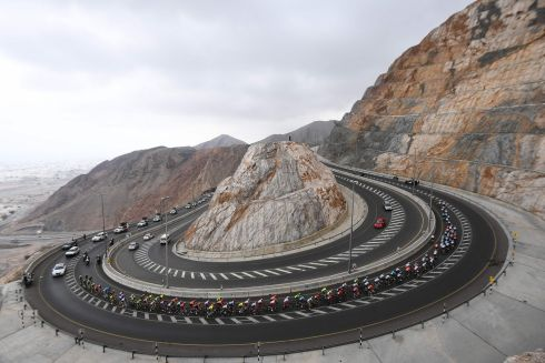 The pack rides the climb of al-Jabal Street during the third stage of the Tour of Oman bicycle race from Shati Al-Qurm to Qurayyat. Photograph: by Anne-Christine Poujoulat/AFP/Getty Images