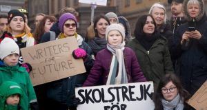 Schoolgirl Greta Thunberg (centre) during a demonstration calling for climate action  in Stockholm last Friday.  Photograph: Elisabeth Ubbe/New York Times