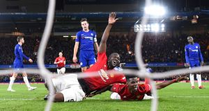 Paul Pogba of Manchester United celebrates with Romelu Lukaku after scoring his team's second goal during the FA Cup fifth round win over Chelsea at Stamford Bridge. Photo: Michael Regan/Getty Images