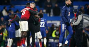 Manchester United's Paul Pogba and Ole Gunnar Solskjaer after their FA Cup fifth round win over Chelsea. Photo: Nigel French/PA Wire