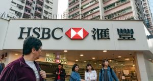 Pedestrians stand outside an HSBC Holdings Plc bank branch in Hong Kong. Photograph: Anthony Kwan/Bloomberg