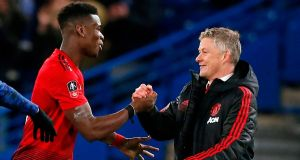 Paul Poga and Ole Gunnar Solskjaer celebrate after Manchester United's win over Chelsea in the FA Cup. Photograph: Ian Kington/AFP/Getty