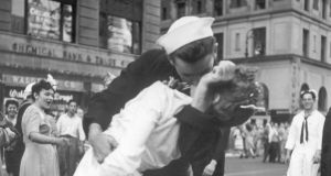 A sailor and a woman kissing in Times Square as people celebrate the end of second World War on August 14th, 1945, in New York. Photograph: Victor Jorgenson/US Navy via The New York Times