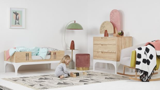 Coco is a three-in-one solid ash and ply bed that will take little Johnny from the cot stage through to the toddler years and then morphs into the cool daybed, pictured.