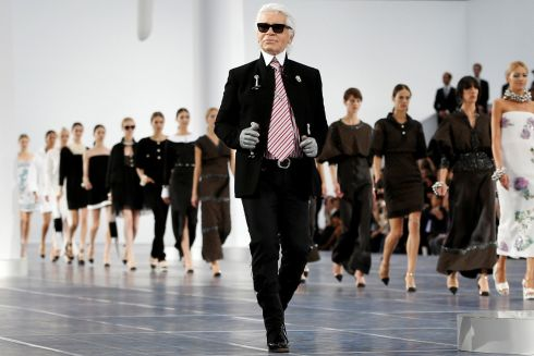 Karl Lagerfeld appears at the end of his Spring/Summer women's ready-to-wear fashion show for Chanel during Paris Fashion Week in  October 2012.  Photograph: Charles Platiau/Reuters