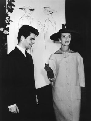 Karl Lagerfeld as young student in about 1953/54 posing with a model during the presentation of a cocktail coat as can been seen in the sketch in the background. Photograph: AFP