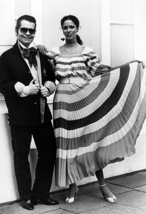 Karl Lagerfeld posing next to a model presenting a dress from his Chloe collection in  May, 1977. Photograph: Werner Baum/AP