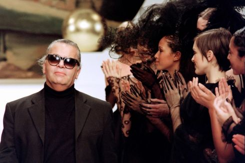 Karl Lagerfeld acknowledges at the end of his show for Chanel as part of his high fashion collection in Paris in January 1994. Photograph: Gerard Julien/AFP