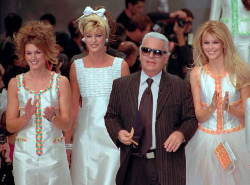 Karl Lagerfeld joins models (from left) Cindy Crawford, Linda Evangelista and Claudia Schiffer after the presentation of his 1996 Spring-Summer ready-to-wear fashion collection for Chanel in Paris. Photograph: Remy de la Mauviniere/AP