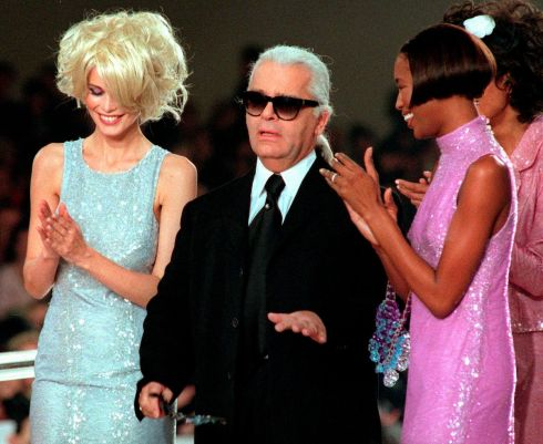 Karl Lagerfeld is applauded by Claudia Schiffer and Naomi Campbell at the end of the Chanel 1997 Spring-Summer ready-to-wear collection presented in Paris. Photograph: Remy de la Mauviniere/AP