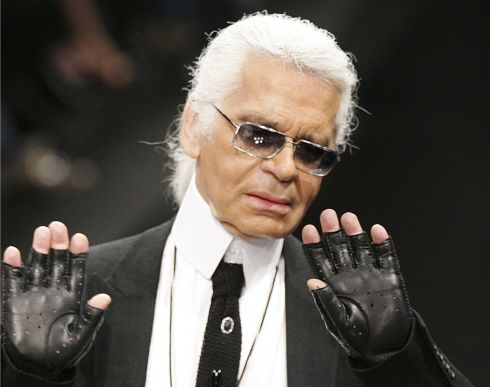Karl Lagerfeld acknowledges the audience at the end of his show for Lagerfeld Gallery during the Spring-Summer 2006 ready-to-wear collections in Paris, in  October 2005. Photograph: Peirre Verdy/AFP