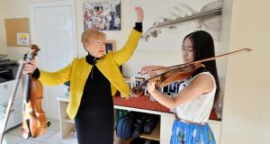 Maria Kelemen, owner of Young European Strings, with violinist Daimee Ng (14). Photograph: Alan Betson