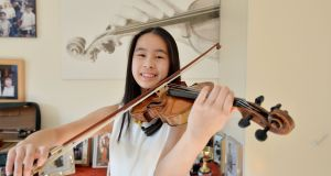 Daimee Ng (14) was just three years old when her mother  enrolled her in structured violin classes.  'I don't feel I've made sacrifices as it has brought me so much pleasure,' she says.  Photograph: Alan Betson / The Irish Times