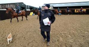 Gordon Elliott gives instructions to jockeys during the stable visit to his yard at Cullentra House. Photograph: Niall Carson/PA Wire