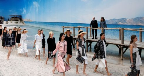 Models present Karl Lagerfeld's Spring-Summer 2019 ready-to-wear collection for Chanel at the Grand Palais transformed as a beach scene during Paris Fashion Week on October 2nd, 2018. Photograph: Stephane Mahe/Reuters
