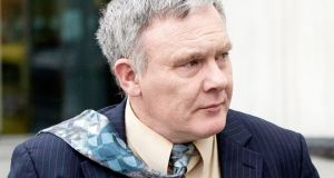 Garda Gerry Canty leaving court on Tuesday after giving evidence in the trial of Patrick Quirke. Photograph: Collins Courts