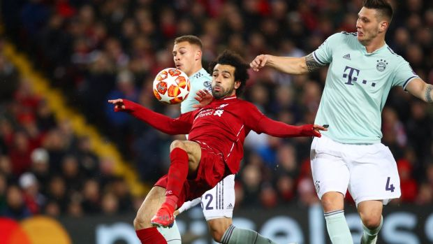 Liverpool's Mohamed Salah battles with Joshua Kimmich and Niklas Suele of Bayern Munich during the Champions League round of 16 first leg at Anfield. Photograph: Clive Brunskill/Getty Images