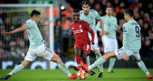 Liverpool's Naby Keita in action against Bayern Munich's James Rodriguez and Robert Lewandowski during the Champions League round of 16 first leg at Anfield. Photograph: Peter Powell/EPA