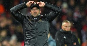 Liverpool manager Jürgen Klopp gestures on the touchline during the  Champions League round of 16 first leg at Anfield stadium. Photograph:  Oli Scarff/AFP/Getty Images