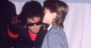 Michael Jackson with James Safechuck, one of his accusers, in 1988. Photograph: Eugene Adebari/Rex Features