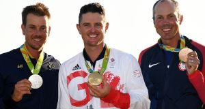Justin Rose, Henrik Stenson and Matt Kuchar with their medals at the Olympic Games in Rio. Photograph: Ross Kinnaird/Getty Images