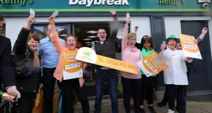 Les Reilly (centre) with the staff from his Daybreak shop in The Naul, north Co Dublin, where the winning €175m EuroMillions ticket was sold. Photograph: Colin Keegan/Collins.