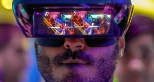 An attendee    tries out the Lenovo augmented reality glasses at the Mobile World Congress in Barcelona in February  2018. Photograph: Reuters