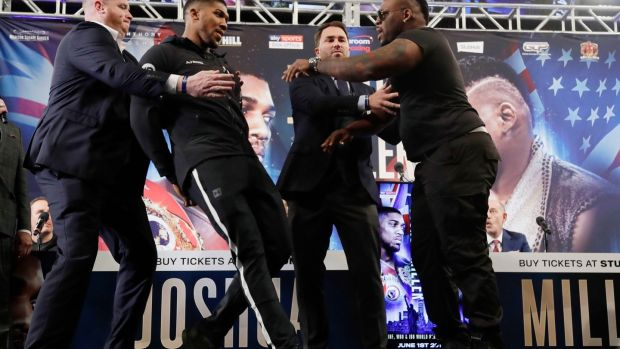 British boxer Anthony Joshua, left, is shoved by Jarrell Miller, right, as they pose for photographs during a news conference in New York to promote their upcoming fight. Photo: Frank Franklin II/AP Photo