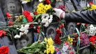 "Flowers being laid at the Maidan activists ""Heavenly Hundred Heroes"" memorial in Kiev. Photograph: Sergei Supinsky"