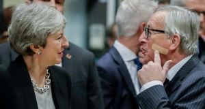 BANDAGE UP: British prime minister Theresa May is welcomed by European Commission president Jean-Claude Juncker ahead of a meeting on Brexit in Brussels. Photograph: Stephanie Lecocq/EPA