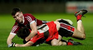 St. Mary's Aaron Boyle clashes with Conor Horgan of UCC during the Sigerson Cup final. Photo: James Crombie/inpho
