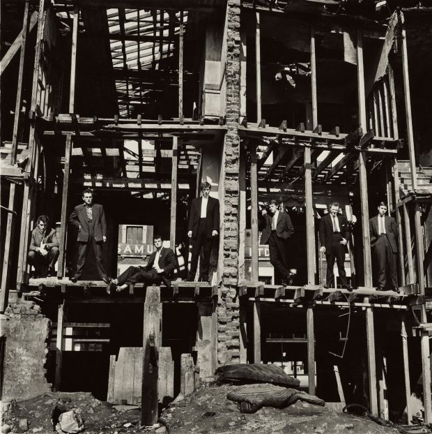 Don McCullin, The Guvnors (1958) – wannabe gangsters pose in a bombed out house. Credit: Don McCullin/Tate