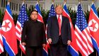 US president Donald Trump poses with North Korea's leader, Kim Jong-un, at the start of their historic US-North Korea summit. Photograph: Saul Loeb / AFP