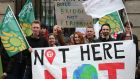 Climate change protesters demonstrated outside Leinster House in Dublin earlier this week.   Photograph: Laura Hutton/The Irish Times