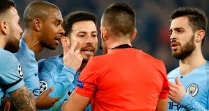 Manchester City's players argue with the referee after he gave the first penalty to Schalke following VAR deliberation. Photograph: Getty Images