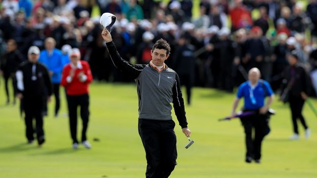 Rory McIlroy salutes the crowd as he makes his way to the 18th green to complete his victory at the 2016 Dubai Duty Free Irish Open. Photograph: Donall Farmer/Inpho