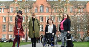 Members of Disabled Women of Ireland, from left, Nem Kearns, Mary Treasa Cahill-Kennedy, Alannah Murray and Róisín Dermody with dog Clipper, at Trinity College Dublin. Photograph: Dara Mac Dónaill / The Irish Times
