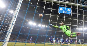 Manchester City's Leroy Sane scores from a free-kick during the Champions League round of 16 first leg  match against Schalke at the Veltins arena   in Gelsenkirchen. Photograph: Friedemann Vogel/EPA