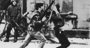 An armed soldier attacks a protester on Bloody Sunday. Photograph: Frederick Hoare/Central Press/Getty Images