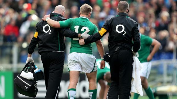 Luke Marshall leaving the field injured in Rome. Photograph: James Crombie/Inpho