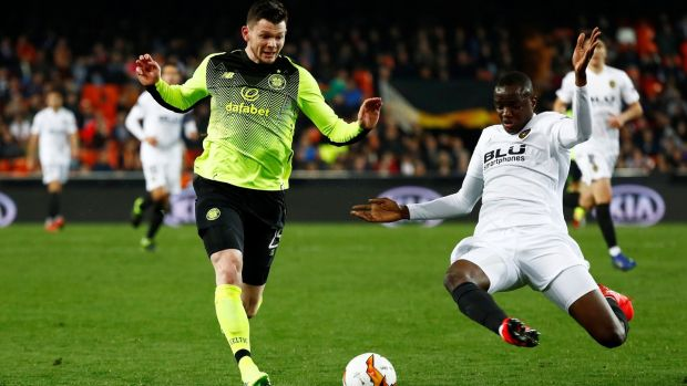 Valencia's Mouctar Diakhaby challenges Celtic's Oliver Burke during the Europa League round of 32 second leg at the Mestalla. Photograph: Juan Medina/Reuters