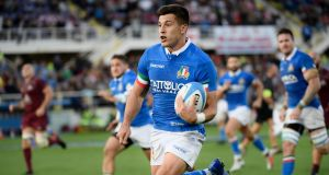 Italy's fly half Tommaso Allan runs on his way to score a try during their international rugby union test match against Georgia in Florence last November.  Photograph: Filippo Monteforte/AFP/Getty Images
