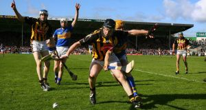 Kilkenny's Michael Rice and Shane McGrath of Tipperary contesting a loose ball during the  League Division One final in 2009. Photograph:  Cathal Noonan/Inpho