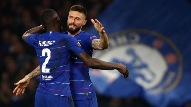Chelsea striker Olivier Giroud celebrates after scoring the opening goal with Antonio Rüdiger during the Europa League round of 32 second leg match against Malmö at Stamford Bridge. Photograph: Julian Finney/Getty Images