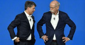 Daimler chief executive Dieter Zetsche (right) with BMW chief executive Harald Krüger in Berlin on Friday. Photograph: John MacDougall / AFP