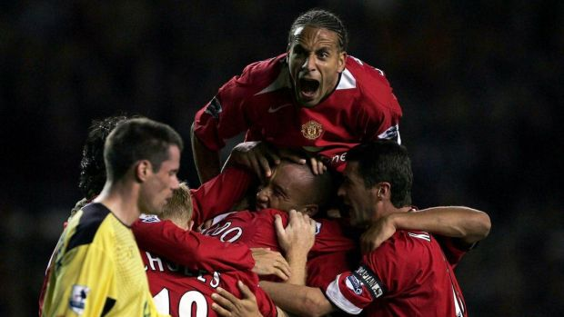 Rio Ferdinand of Manchester United and team-mates jumping on goalscorer Mikael Silvestre during a league game against Liverpool in 2004. Photograph: Getty Images