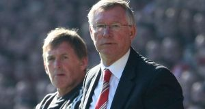 United's Alex Ferguson and Kenny Dalglish of Liverpool  during a  league match at Anfield on October 15th, 2011. Photograph:  Getty Images
